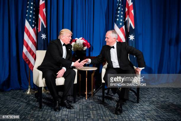 US President Donald Trump and Australian Prime Minister Malcolm Turnbull shake hands before a meeting on board the Intrepid Sea Air and Space Museum...
