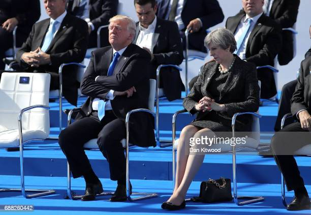 President Donald Trump and British Prime Minister Theresa May are pictured ahead of a photo opportunity of leaders as they arriving for a NATO summit...