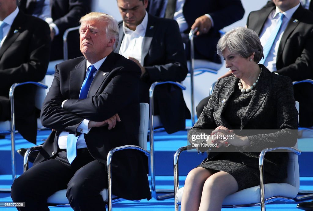 US President, Donald Trump and British Prime Minister, Theresa May are pictured ahead of a photo opportunity of leaders as they arrive for a NATO summit meeting on May 25, 2017 in Brussels, Belgium. The North Atlantic Treaty Organisation (NATO) is made up of 28 countries. This year's summit is held at their new headquarters in Brussels. The US President Donald Trump will meet other leaders to discuss NATO taking a greater role in the fight against ISIS.