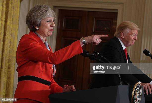 S President Donald Trump and British Prime Minister Theresa May participate in a joint press conference in the East Room of the White House January...