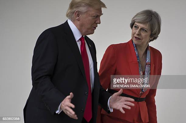 US President Donald Trump and British Prime Minister Theresa May walk at the White House on January 27 2017 in Washington DC / AFP / Brendan...