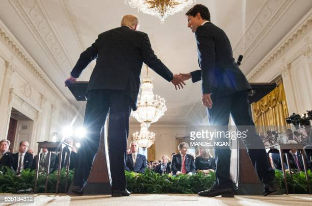US President Donald Trump and Canada's Prime Minister Justin Trudeau shake hands during a joint press conference in the East Room of the White House...