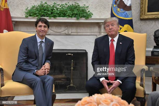 US President Donald Trump and Canadian Prime Minister Justin Trudeau look on during their meeting at the White House in Washington DC on October 11...