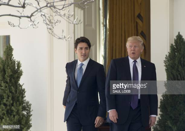 US President Donald Trump and Canadian Prime Minister Justin Trudeau exit the Oval Office between meetings at the White House in Washington DC...