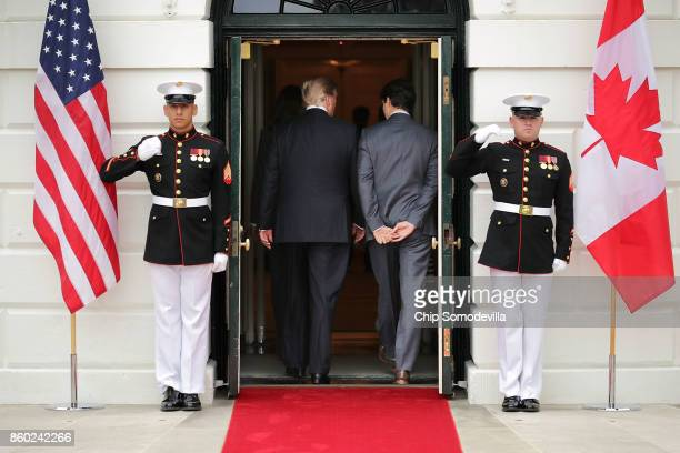 S President Donald Trump and Canadian Prime Minister Justin Trudeau walk into the White House October 11 2017 in Washington DC The United States...