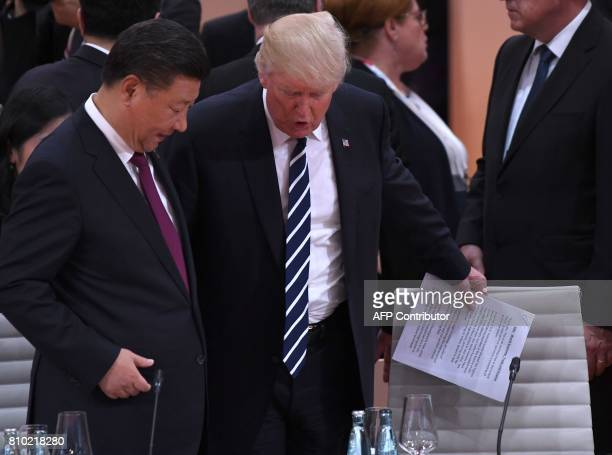 US President Donald Trump and China's President Xi Jinping arrive for a working session on the first day of the G20 summit in Hamburg northern...