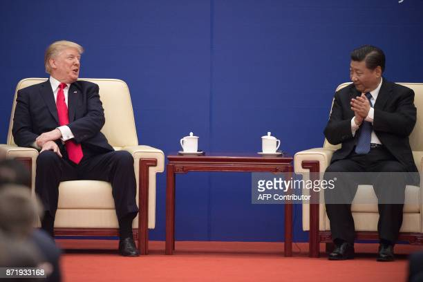 US President Donald Trump and China's President Xi Jinping attend a business leaders event inside the Great Hall of the People in Beijing on November...