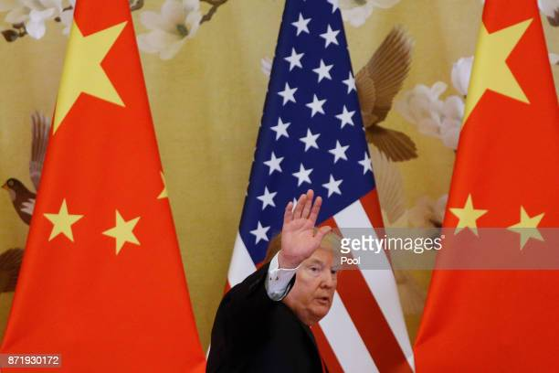 S President Donald Trump and China's President Xi Jinping make a joint statement at the Great Hall of the People on November 9 2017 in Beijing China...