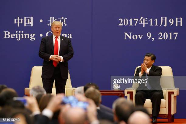S President Donald Trump and China's President Xi Jinping meet business leaders at the Great Hall of the People on November 9 2017 in Beijing China...