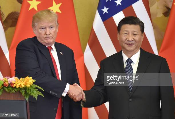 US President Donald Trump and Chinese President Xi Jinping shake hands at a joint news conference held after their meeting in Beijing on Nov 9 2017...