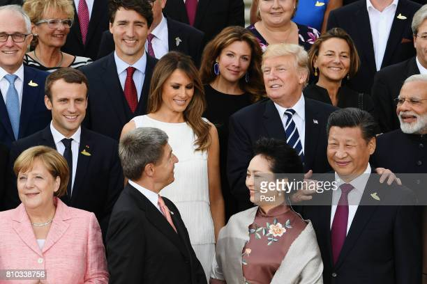S President Donald Trump and First Lady Melania pose with G20 leaders and their spouses upon their arrival at the Elbphilharmonie philharmonic...