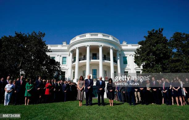 President Donald Trump and First Lady Melania Trump along with Vice President Mike Pence and his wife Karen Pence take part in a moment of silence...