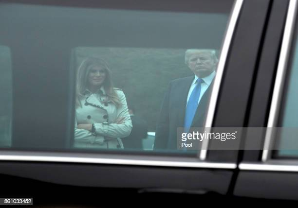 US President Donald Trump and First lady Melania Trump are framed through the window of the limousine that was used by United States President Bill...