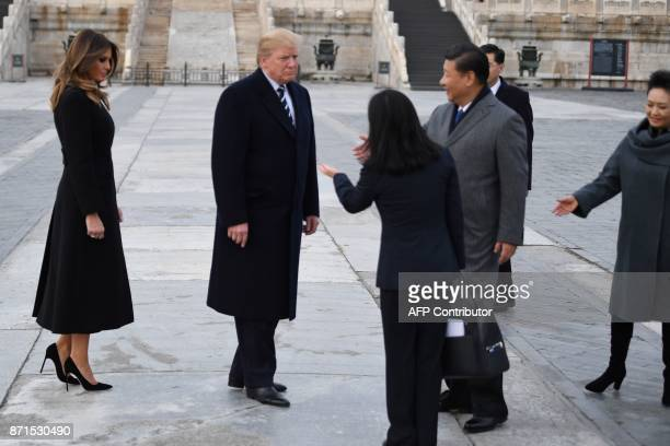 US President Donald Trump and First Lady Melania Trump are greeted by China's President Xi Jinping and his wife Peng Liyuan in the Forbidden City in...