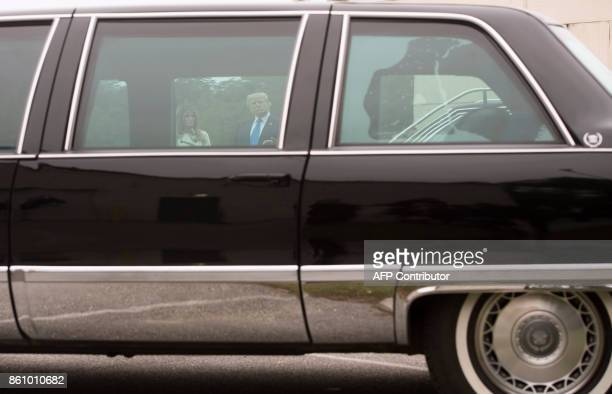 US President Donald Trump and First Lady Melania Trump are seen through the window of a 1993 Cadillac limousine used by former US President Bill...