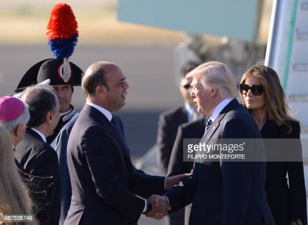 US President Donald Trump and First Lady Melania Trump are welcomed by Foreign Affairs Minister Angelino Alfano upon arrival at Rome's Fiumicino...