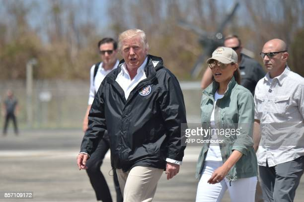 US President Donald Trump and First Lady Melania Trump arrive at Luis Muñiz Air National Guard Base in Carolina Puerto Rico on October 3 2017...
