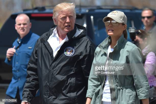 US President Donald Trump and First Lady Melania Trump arrive at Luis Muñiz Air National Guard Base in Carolina Puerto Rico on October 3 2017 Nearly...
