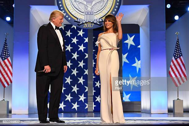 President Donald Trump and First Lady Melania Trump arrive at the Freedom Ball on January 20 2017 in Washington DC Trump will attend a series of...