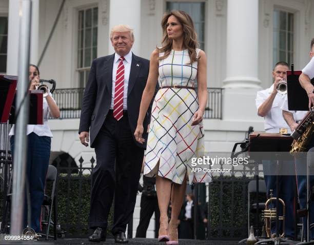 US President Donald Trump and First Lady Melania Trump arrive at the Congressional picnic at the White House in Washington DC on June 22 2017 / AFP...