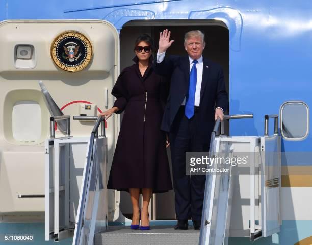 US President Donald Trump and First Lady Melania Trump arrive at the Osan Air Base in Pyeongtaek south of Seoul on November 7 2017 Trump's marathon...