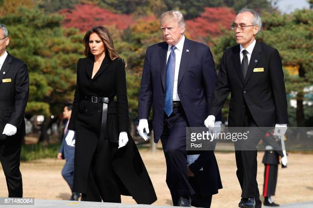 S President Donald Trump and first lady Melania Trump arrive at the National Cemetery on November 8 2017 in Seoul South Korea Trump is in South Korea...
