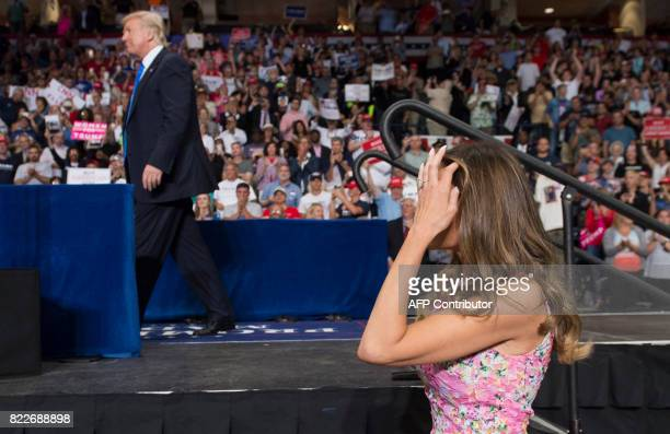 US President Donald Trump and First Lady Melania Trump arrive during a Make America Great Again rally at the Covelli Centre in Youngstown Ohio July...