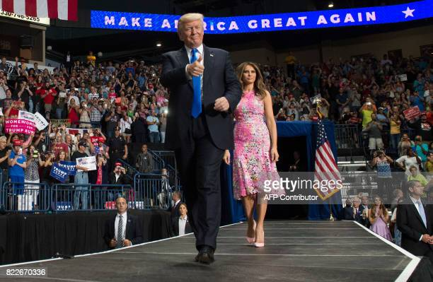 US President Donald Trump and First Lady Melania Trump arrive for a 'Make America Great Again' rally at the Covelli Centre in Youngstown Ohio July 25...