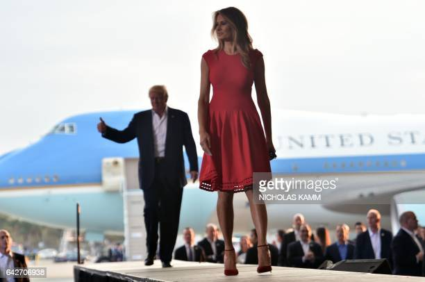 US President Donald Trump and First Lady Melania Trump arrive for a rally on February 18 2017 in Melbourne Florida / AFP / Nicholas Kamm