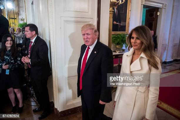 President Donald Trump and first lady Melania Trump arrive for a women's empowerment panel in the East Room of the White House in Washington DC on...
