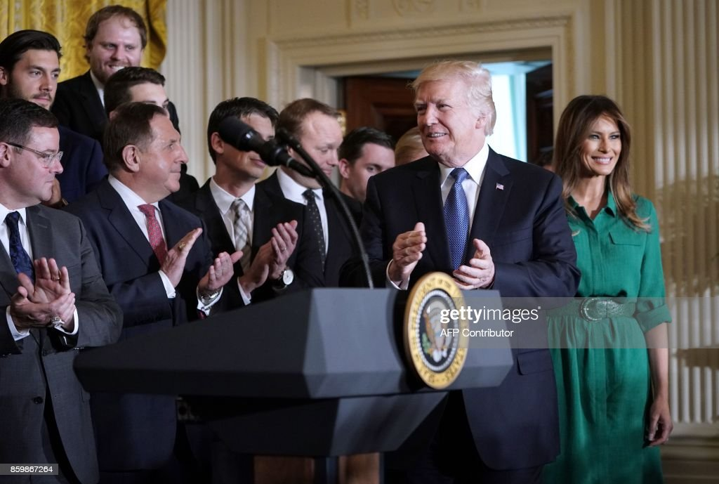 US President Donald Trump and First Lady Melania Trump arrive for an event honouring the 2017 Stanley Cup Champions, The Pittsburgh Penguins, in the East Room of the White House in Washington, DC, on October 10, 2017. / AFP PHOTO / Mandel NGAN