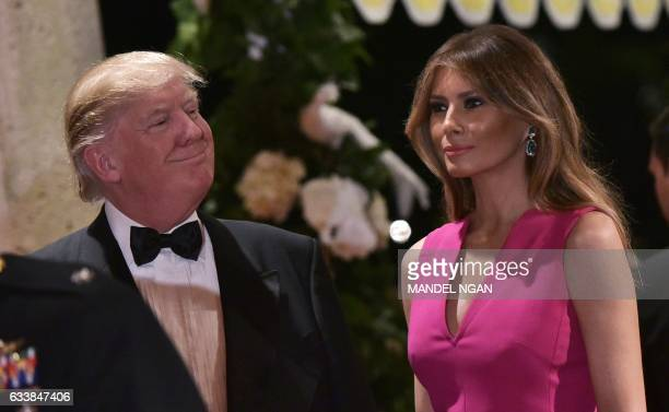 President Donald Trump and First Lady Melania Trump arrive for the 60th Annual Red Cross Gala at his MaraLago estate in Palm Beach on February 4 2017...