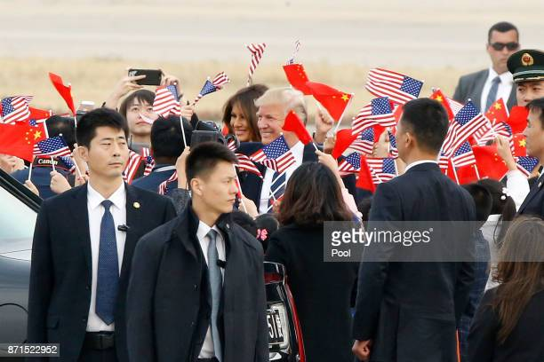 S President Donald Trump and first lady Melania Trump arrive on November 8 2017 in Beijing China Trump is in China as a part of his Asian tour