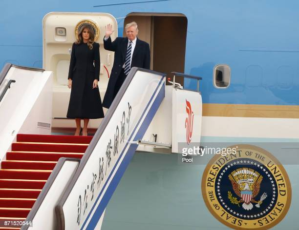 S President Donald Trump and first lady Melania Trump arrive on Air Force One on November 8 2017 in Beijing China Trump is in China as a part of his...