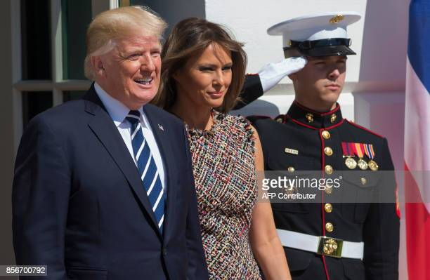 US President Donald Trump and First Lady Melania Trump arrive to greet Thai Junta Chief Prayut ChanOCha and his wife Naraporn ChanOCha as they arrive...