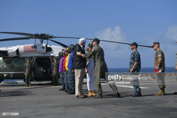 US President Donald Trump and First Lady Melania Trump arrive to meet with US Virgin Islands Governor Kenneth Mapp aboard the USS Kearsarge off...