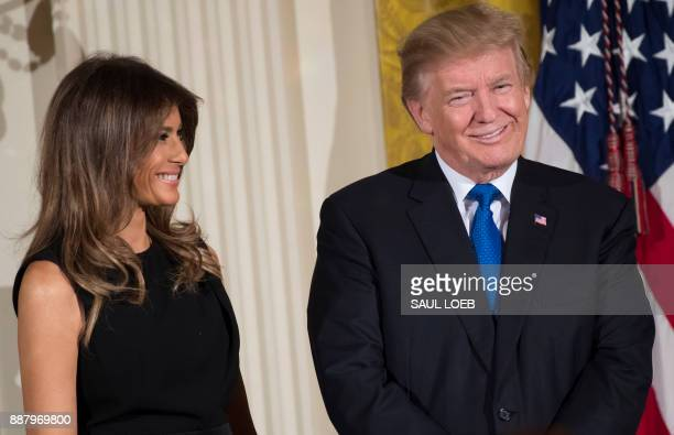 US President Donald Trump and First Lady Melania Trump attend a Hanukkah reception in the East Room of the White House in Washington DC December 7...