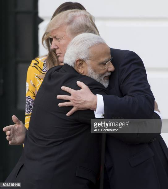 US President Donald Trump and First Lady Melania Trump bid farewell to Indian Prime Minister Narendra Modi on the South Lawn of the White House in...