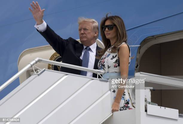 US President Donald Trump and First Lady Melania Trump board Air Force One prior to departing Paris Orly Airport on July 14 following a twoday trip...