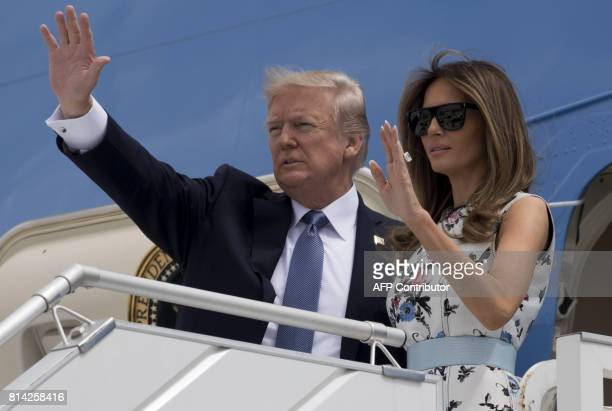 President Donald Trump and First Lady Melania Trump board Air Force One prior to departing Paris Orly Airport on July 14 following a twoday trip for...