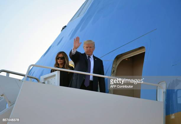 US President Donald Trump and First Lady Melania Trump board Air Force One before departing from Andrews Air Force Base in Maryland en route Las...