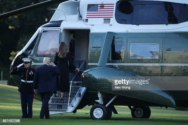 S President Donald Trump and first lady Melania Trump board the Marine One for their departure from the South Lawn of the White House October 4 2017...