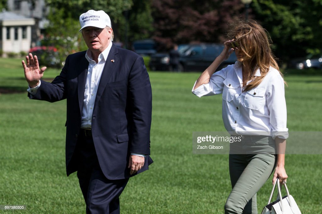 President Donald Trump and First Lady Melania Trump cross the South Lawn after arriving at The White House on June 18, 2017 in Washington, D.C. President Trump spent the weekend at Camp David.