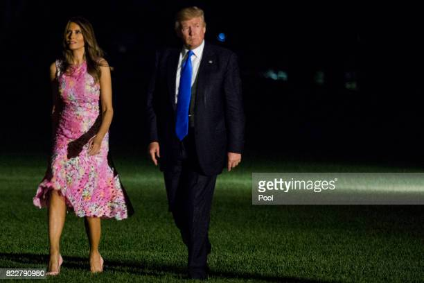 S President Donald Trump and first lady Melania Trump cross the South Lawn after arriving at the White House July 25 2017 in Washington DC The Trumps...