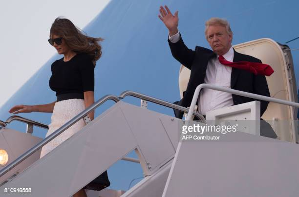 US President Donald Trump and First Lady Melania Trump disembark from Air Force One upon arrival at Andrews Air Force Base in Maryland July 8...
