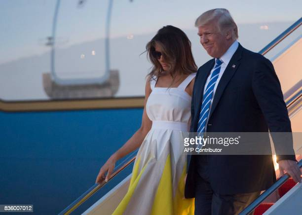 US President Donald Trump and First Lady Melania Trump disembark from Air Force One upon arrival at Andrews Air Force Base in Maryland August 20...