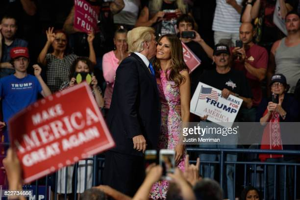 S President Donald Trump and first lady Melania Trump embrace after a rally at the Covelli Centre on July 25 2017 in Youngstown Ohio The rally...