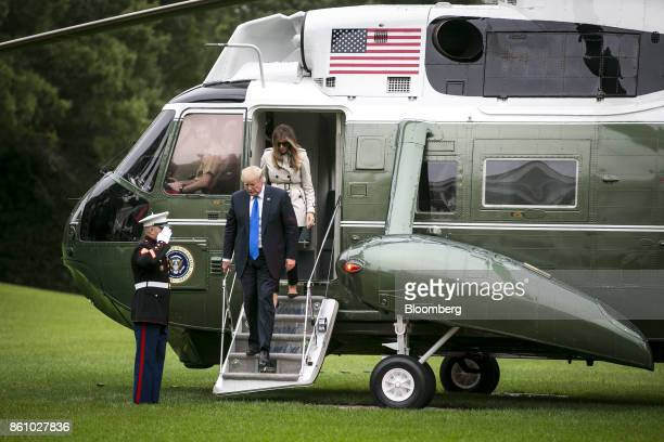 US President Donald Trump and First Lady Melania Trump exit Marine One on the South Lawn of the White House in Washington DC US on Friday Oct 13 2017...
