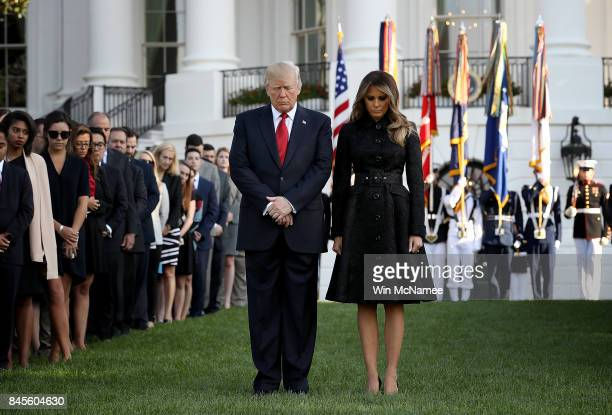 S President Donald Trump and first lady Melania Trump flanked by White House staff observe a moment of silence on the South Lawn of the White House...