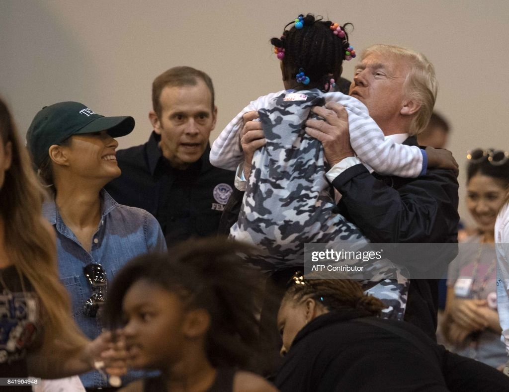 President Donald Trump and First Lady Melania Trump greet a young Hurricane Harvey victim at NRG Center in Houston on September 2, 2017. /